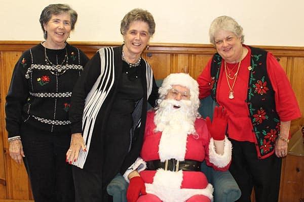 Santa and RSVP Volunteers Shirley Mullins, Rosemary Jones, and Brenda Arnold. Photo Credit: Tonia Winn