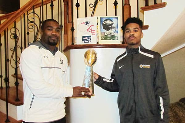 Pierson Prioleau of the Super Bowl Championship New Orleans Saints football team is picture with his son PJ Prioleau