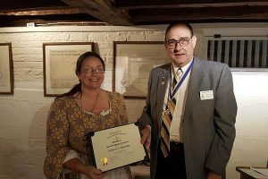 April Danner (L) receives a Certificate of Appreciation from President Terry Blevins (R)