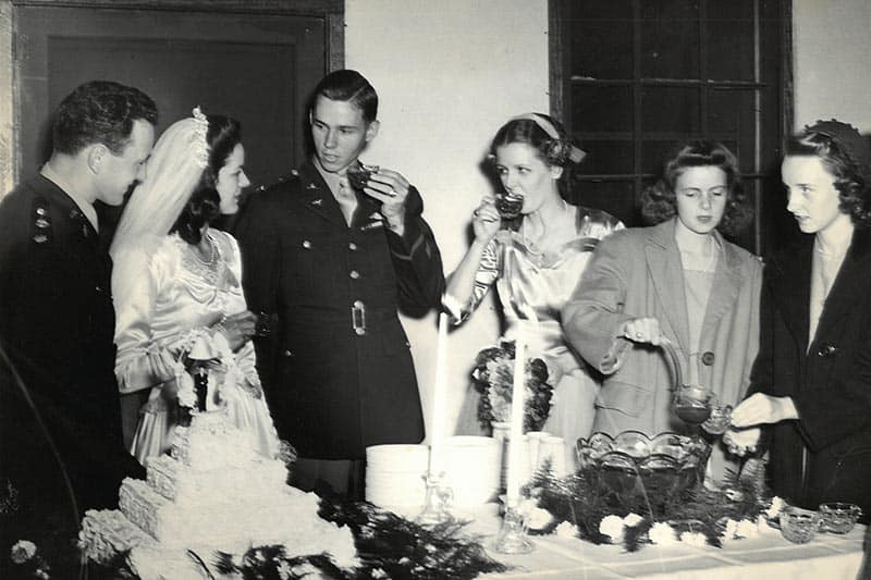Reception picture from 1944 wedding of Major Robert L. DuBose and his wife Meta (first two on left side). The wedding dress shown will be on display at Glencoe. Image Courtesy Marsha DuBose