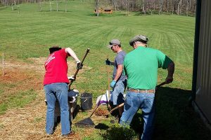 Volunteers work on an outdoor beautification project in preparation for the upcoming events season at Chantilly Farm.