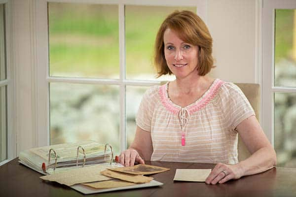 """1. Sue Bell, great-great-granddaughter of Gen. Gabriel C. Wharton, with the binder of Wharton documents she took to the """"Antiques Roadshow."""" Courtesy Sue Bell."""