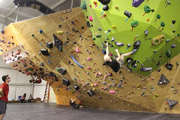 climbers on boulder