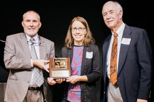 Floyd Chamber Business of the Year award: From left to right are John McEnhill, Floyd Chamber Executive Director; Wanda Combs, General Manager and Editor of The Floyd Press; and Shep Nance, Floyd Chamber Board President.