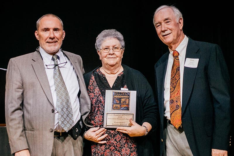 Floyd Chamber Executive Director's Award: John McEnhill, Floyd Chamber Executive Director; Barbara Harman, Floyd County Visitor Center; and Shep Nance, Floyd Chamber Board President.