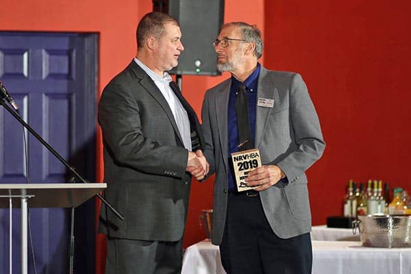 Ed Tuchler, Shelter Alternatives, Inc. owner accepts award from NRVHBA president Sean Belliveau. Photo Credit: Holly Cromer.